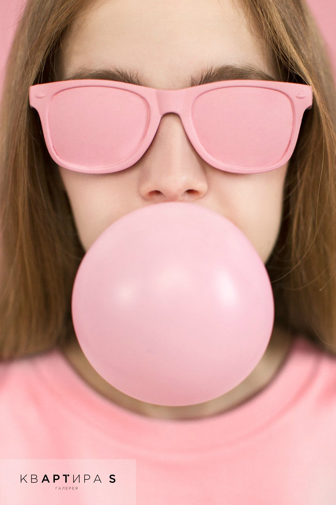 Young woman or teenage girl blowing bubble gum stock image